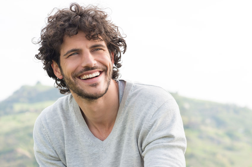 curly hair man smiling