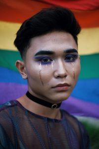 asian man wearing makeup