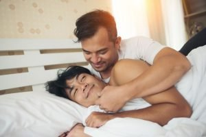 gay asian couple in bed